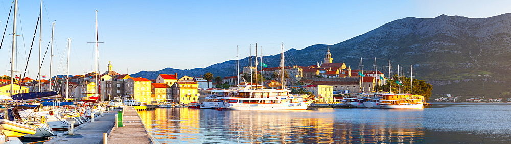 The picturesque coastal village of Korcula illuminated at sunrise, Korcula Town, Korcula, Dalmatia, Croatia, Europe