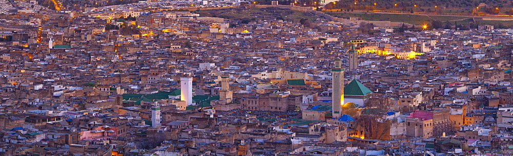 Elevated view across the Old Medina of Fes illuminated at dusk, UNESCO World Heritage Site, Fes, Morocco, North Africa, Africa