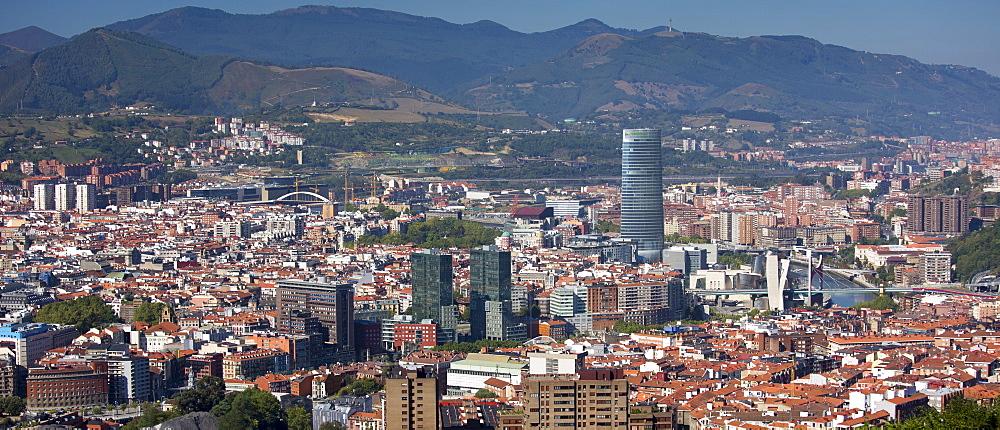 Aerial view of Bilbao Guggenheim Museum, Iberdrola Tower skyscraper and Red Bridge in Basque country, Spain