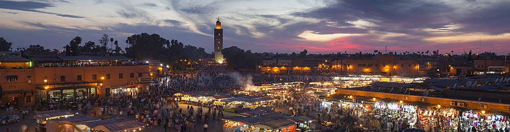Panoramic view of (Jemaa) Djemaa el Fna square and Koutoubia Mosque, sunset, Marrakech, Morocco, North Africa, Africa