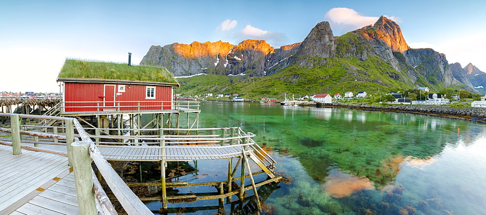 Panoramic of the fishing village surrounded by sea and midnight sun, Reine, Nordland county, Lofoten Islands, Arctic, Northern Norway, Scandinavia, Europe