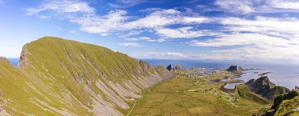 Mountain ridge frames the village of Sorland surrounded by sea, Vaeroy Island, Nordland county, Lofoten archipelago, Norway, Scandinavia, Europe