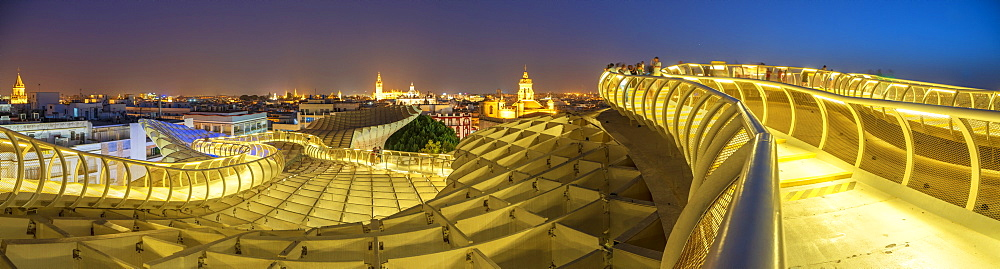 Panoramic of reticular structure and curved footbridge of Metropol Parasol, Plaza de la Encarnacion, Seville, Andalusia, Spain, Europe