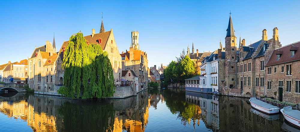 Belfort van Brugge and medieval buildings on the Dijver canal from Rozenhoedkaai at dawn, Bruges, West Flanders (Vlaanderen), Belgium, Europe