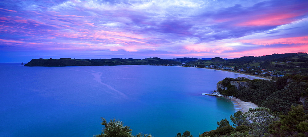 Dusk falls above Cooks Bay on the Pacific Ocean coast of the Coromandel Peninsula, North Island, New Zealand, Pacific