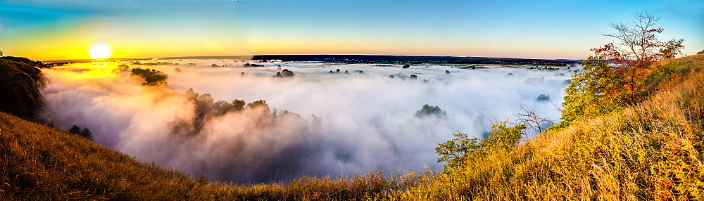 Misty dawn over hills and river, Ukraine, Europe