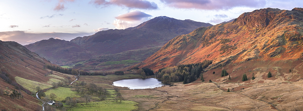 Stitched panoramic image showing sunrise at Blea Tarn in autumn, Lake District National Park, UNESCO World Heritage Site, Cumbria, England, United Kingdom, Europe - 1266-122