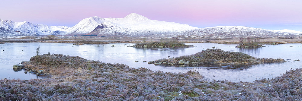 Pink sunrise and snow covered Black Mount from a frozen Lochan-na h'achlaise, Rannoch Moor, Glencoe, Highlands, Scotland - 1266-91