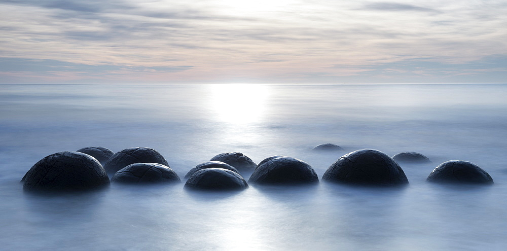 Moeraki boulders with a long exposure at Moeraki Beach, Otago, South Island, New Zealand, Pacific