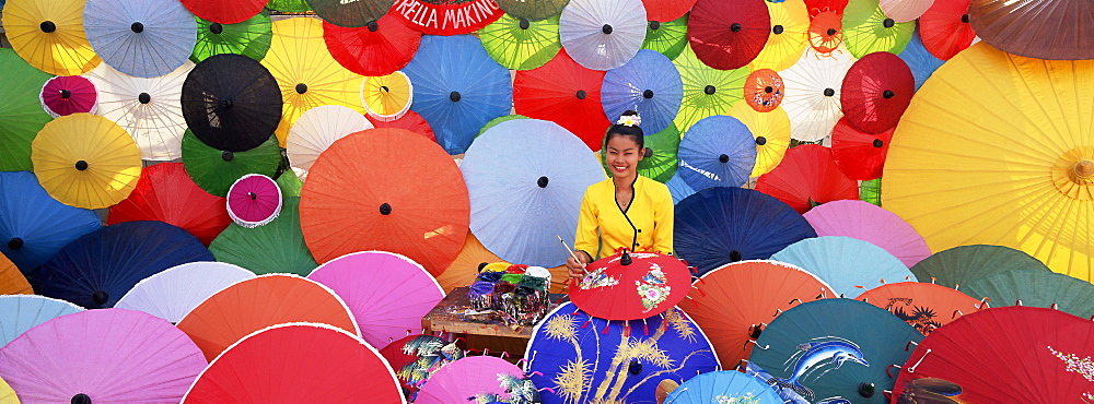 Woman painting umbrellas, Bo Sang umbrella village, Bo Sang, Chiang Mai, Thailand, Asia