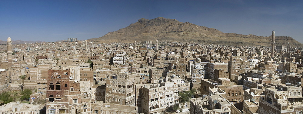 View across Old City of traditional tall brick-built houses, Sana'a, UNESCO World Heritage Site, Yemen, Middle East