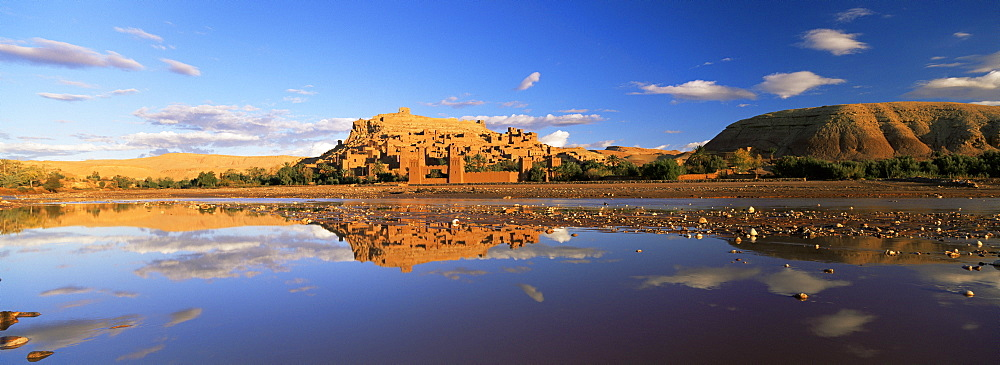 Reflections of kasbah in river, Kasbah Ait Benhaddou, UNESCO World Heritage Site, near Ouarzazate, Morocco, North Africa, Africa