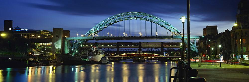 Dusk view towards Tyne Bridge over River Tyne, Quayside, Newcastle upon Tyne, Tyne and Wear, England, United Kingdom, Europe