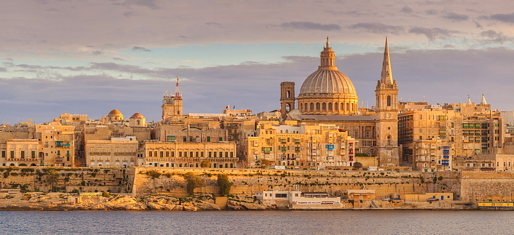 Valletta skyline panorama at sunset with the Carmelite Church dome and St. Pauls Anglican Cathedral, Valletta, Malta, Mediterranean, Europe