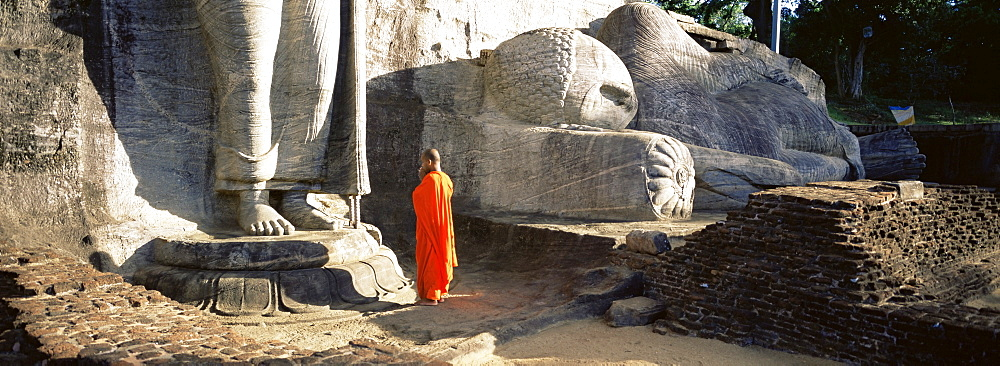 Buddhist monk at the Gal Vihara, Polonnaruwa (Polonnaruva), UNESCO World Heritage Site, Sri Lanka, Asia