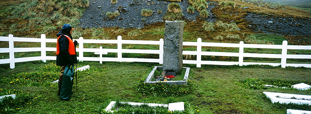 Tourist at Shackleton's Grave, Grytviken, South Georgia, South America