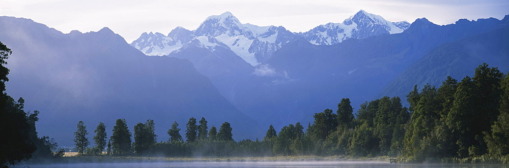 Trees in front of lake, Lake Matheson, Westland National Park, South Island New Zealand, New Zealand