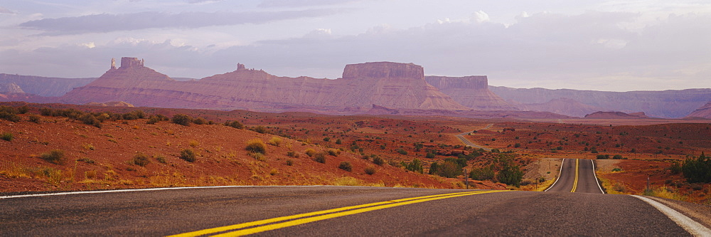 Highway passing through an arid landscape, Monument Valley Tribal Park, Arizona, USA - 752-1725