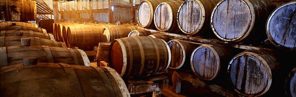 Australia, Queensland, Toowoomba, Barrels of wine in a warehouse