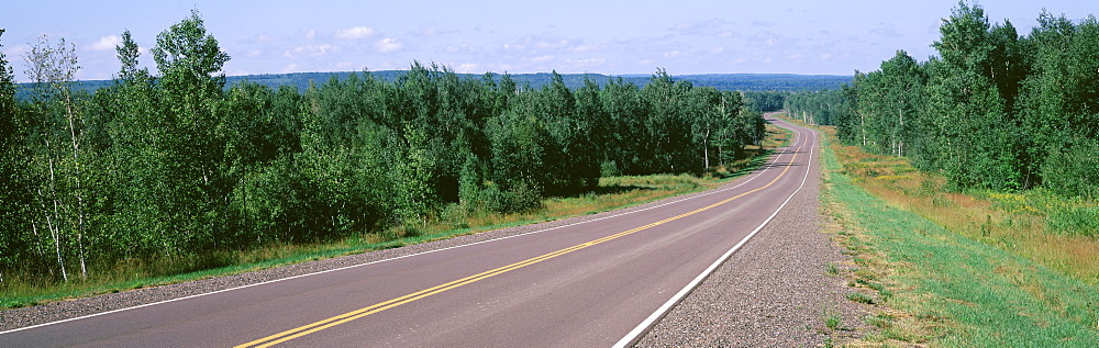 Trees on both sides of a highway, Route 13, Bayfield, Wisconsin, USA