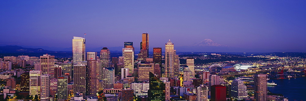 High angle view of buildings lit up at dusk, Seattle, Washington State, USA
