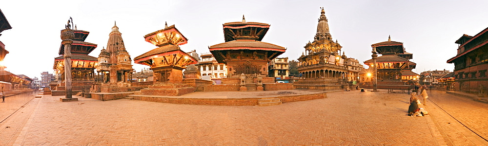 Buildings in Durbar Square, from the left, Hari Shankar Mandir, statue of Yoganarendra Malla on pillar, shikhara style temple, two pagoda roofed temples the right hand unlit one being the Jagan Naryan Mandir, the shikhara style Krishna Mandir, column topped by Garuda, the Bishwanath Mandir and on the extreme right the Patan Museum in the Old Royal Palace, UNESCO World Heritage Site, Patan, Kathmandu Valley, Nepal, Asia