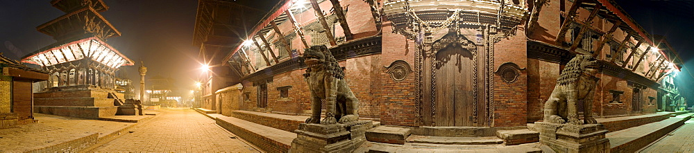 Two stone lions guard the entrance to Mul Chowk courtyard in the Old Royal Palace, with the Hari Shankar Mandir Hindu temple to the left, Durbar Square, UNESCO World Heritage Site, Patan, Kathmandu Valley, Nepal, Asia