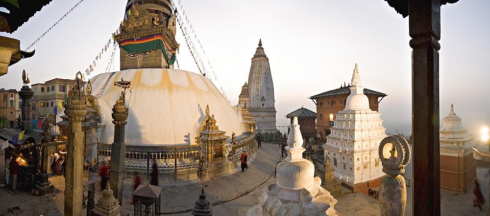 A panorama formed of three frames giving a very wide angle view, taken at dawn at the Buddhist stupa of Swayambu (Swayambhunath) (Monkey Temple), overlooking the Kathmandu valley, UNESCO World Heritage Site, Kathmandu, Nepal, Asia