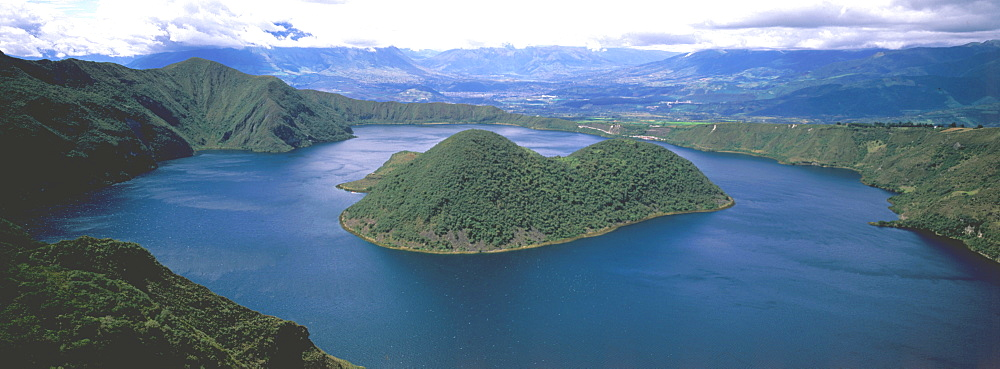Laguna Cuicocha nestles in the crater of an extinct volcano above the town of Cotacachi and an easy excursion north of Otavalo, Highlands north of Quito, Ecuador