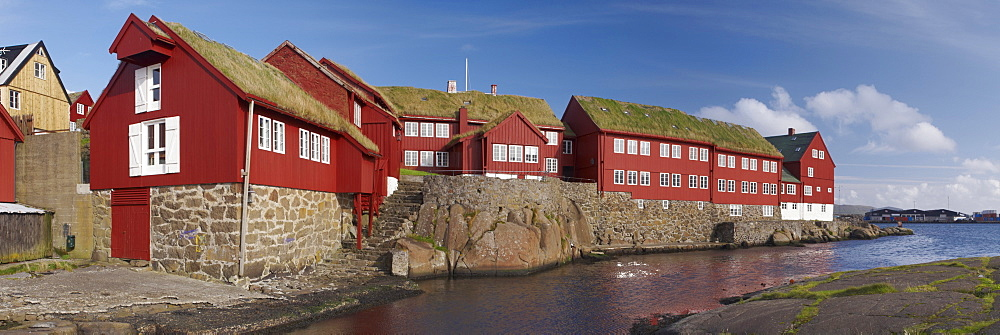 Panoramic view of traditional turf-roofed government buildings on Tinganes peninsula, Torshavn, Streymoy, Faroe Islands (Faroes), Denmark, Europe