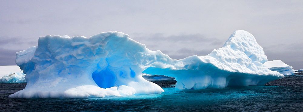 Weathered iceberg in the Iceberg Graveyard off Pleneau Island, Antarctic Peninsula, Antarctica, Polar Regions