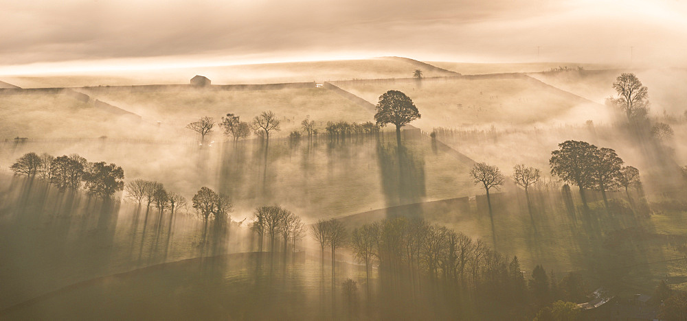 Stock photo of Early morning mist covered farmland in autumn