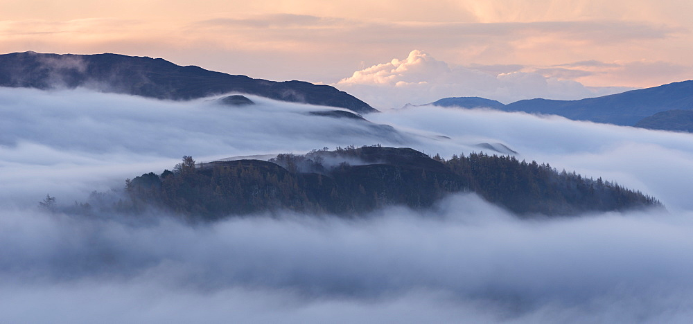 Mist covered landscape at dawn in autumn, near Derwent Water, Lake District National Park, Cumbria, England, United Kingdom, Europe