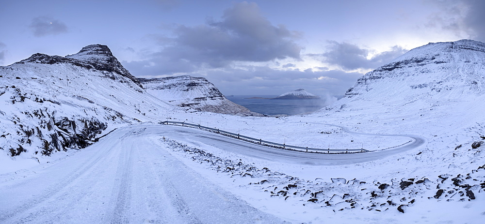 Snow covered mountain road in winter on the Island of Streymoy, Faroe Islands, Denmark, Europe