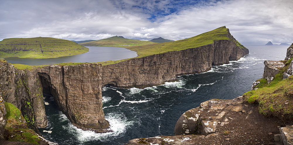 The dramatic Vagar coastline from Traelana?pa cliff above Sorvagsvatn Lake in the Faroe Islands, Denmark, Europe