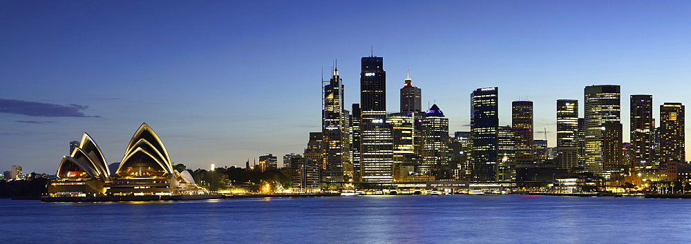 Sydney Opera House and skyline at dusk, Sydney, New South Wales, Australia
