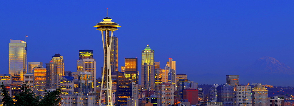Panoramic night shot, skyline of the Financial District in Seattle with Space Needle, Columbia Center, formerly known as Bank of America Tower, Washington Mutual Tower, Two Union Square Tower, Municipal Tower, formerly Key Tower and the U.S. Bank Center,