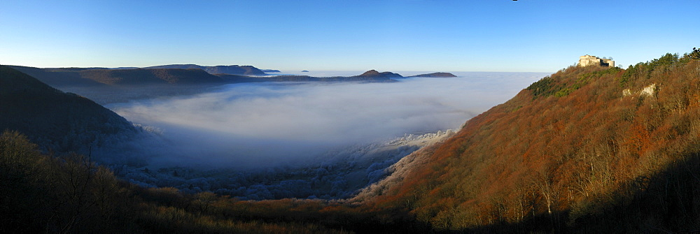 Burg Hohenneuffen Castle above a fog-filled valley, Swabian Alb, Baden-Wuerttemberg, Germany, Europe