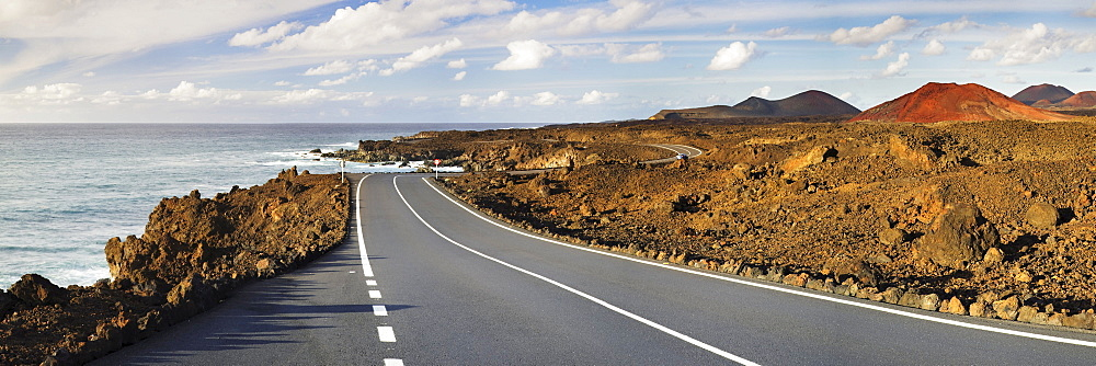 Road on the west coast through a volcanic landscape, Lanzarote, Canary Islands, Spain, Europe