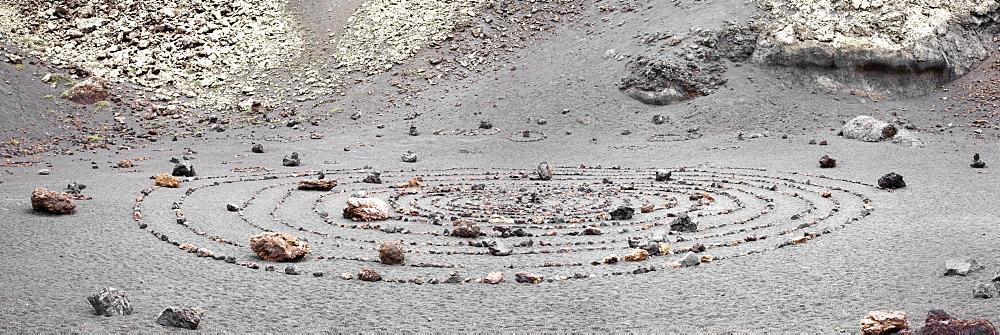 Stone circle inside the extinct volcano of Monte del Cuevo, Parque Natural de los Volcanos, Lanzarote, Canary Islands, Spain, Europe