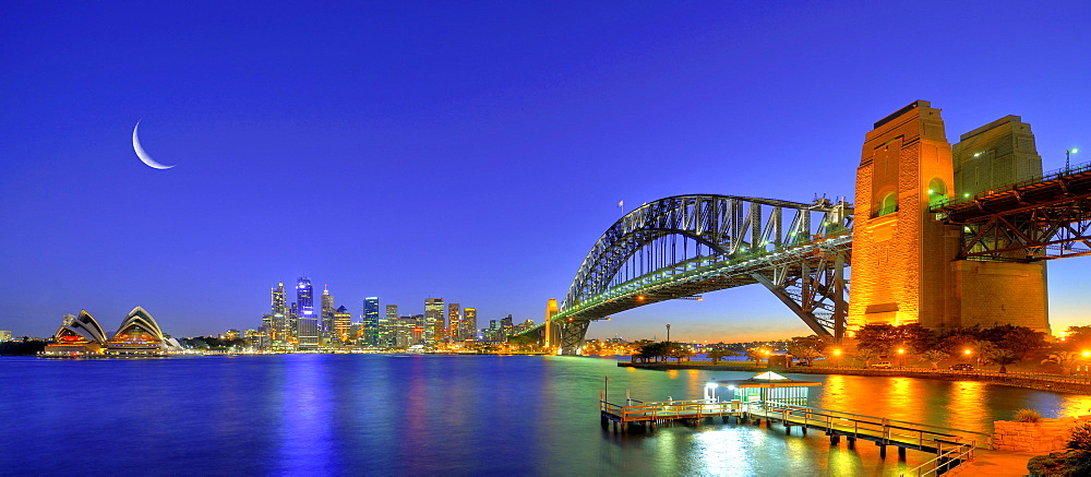 Panorama shot of the Sydney Opera House, Sydney Harbour Bridge, Harbour, Sydney skyline, Central Business District, moon, night shot, Sydney, New South Wales, Australia