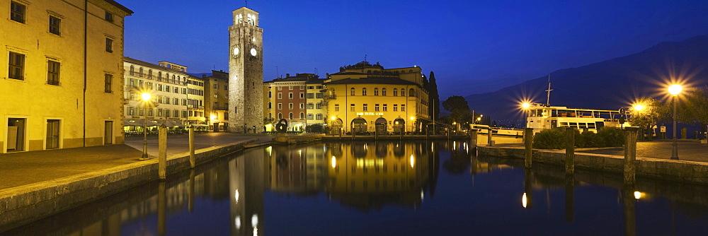 The old town of Riva del Garda reflected in the port basin, Lake Garda, Trentino, Alto Adige, Italy, Europe