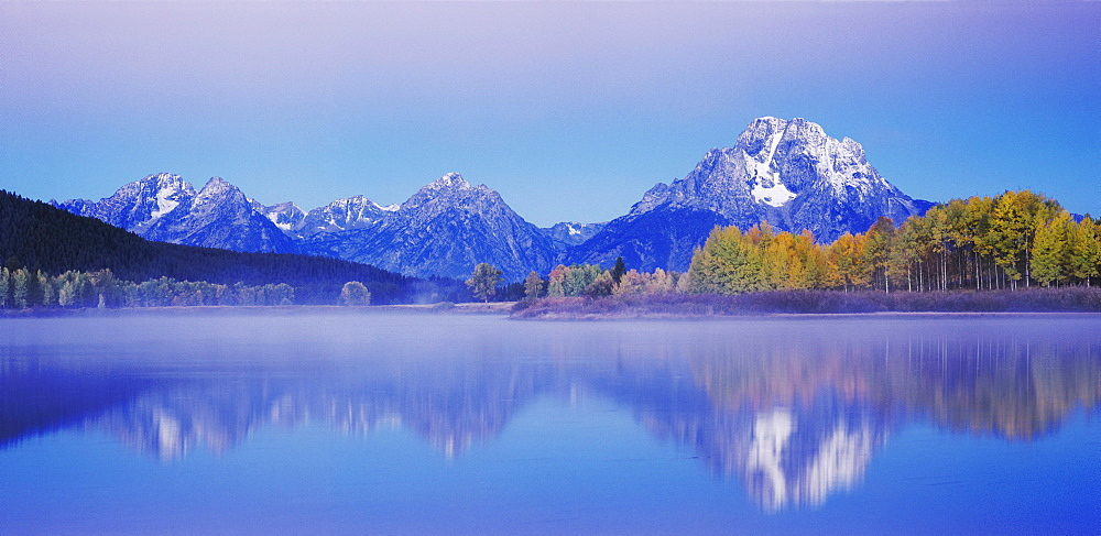 Mt. Moran and Teton Range reflected in Snake River at dawn, Oxbow Bend, Grand Teton National Park, Wyoming, USA