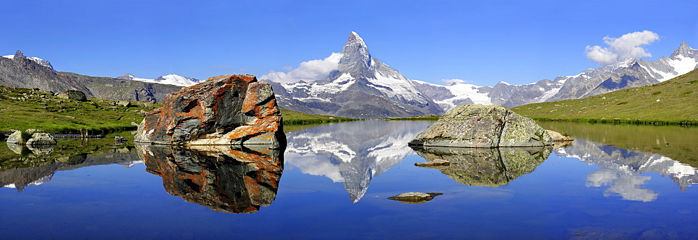 The Matterhorn is reflected in the Stellisee near Zermatt, canton Wallis, Switzerland