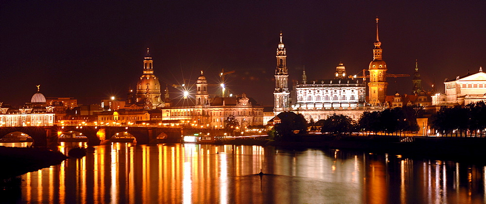 World cultural heritage DRESDEN at the River Elbe. Nocturnal panorama of the baroque city with Elbbruecken. Germany