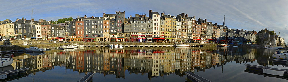 The houses at the old harbor, Vieux Bassin, of Honfleur and their reflection in the calm water, Basse-Normandie, France, Europe