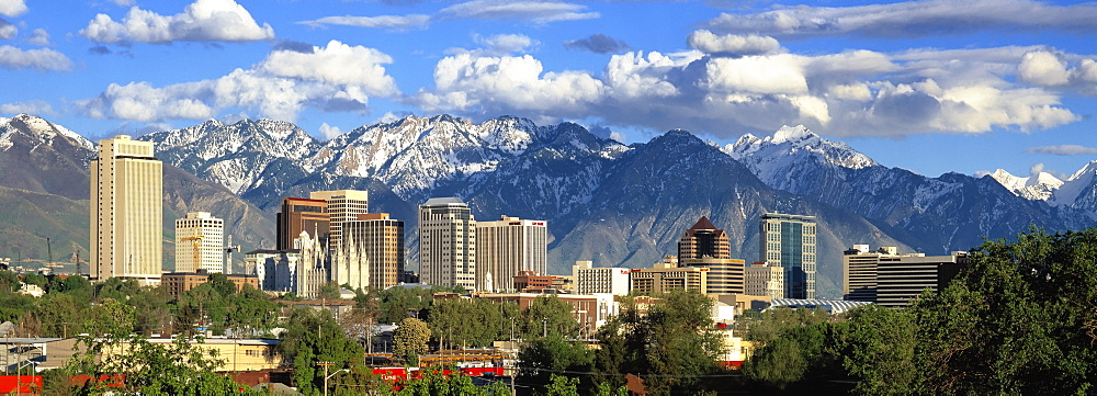 Panoramic view of the Salt Lake City skyline and the snow-covered Wasatch Mountains at back, Utah, USA