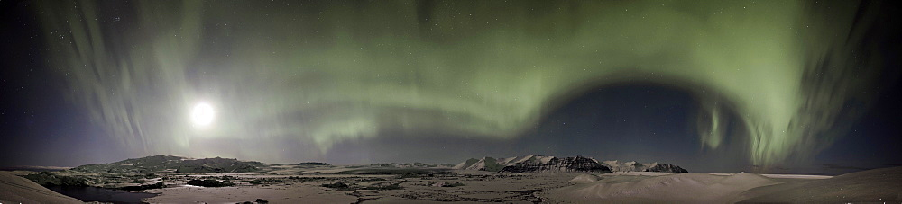 Panoramic view, green Northern Lights, Aurora Borealis, with the moon above the Joekulsárlón glacial lagoon and the Breiðamerkurjoekull, Breidamerkurjoekull and Vatnajoekull glaciers, Vatnajoekull National Park, Iceland, Europe