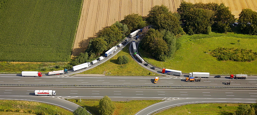 Aerial view, traffic backed up due to an accident resulting in closure of the highway, traffic leaving the exit Hamm via the entry lane, Ruhr Area, North Rhine-Westphalia, Germany, Europe