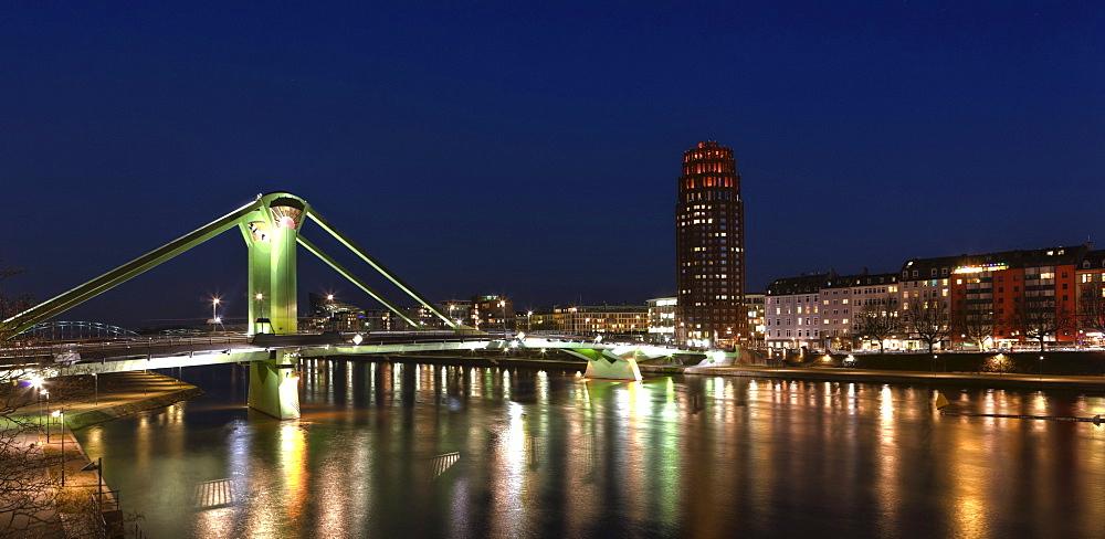 View past Floesserbruecke bridge towards the Main Plaza building, Frankfurt, Hesse, Germany, Europe